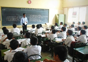 Br Maria Suresh, CSC, at Holy Cross School, Salem