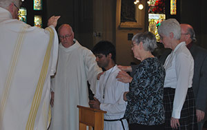 Thomas Gomes, CSC, Receiving a Blessing from the Family of Holy Cross