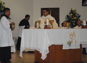 Armando prepares the altar for the Eucharist