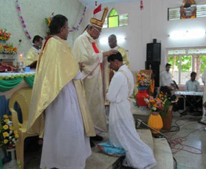 Bishop Devotta lays hands on Gnanam during his Ordination