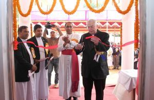 Fr Warner cuts the ribbon at the dedication of Holy Cross College in Agartala