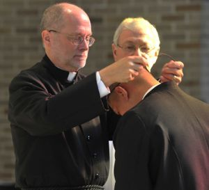 Br Nich receives his St