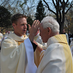 Fr Kevin Grove, CSC gives his blessing to Fr Theodore hesburgh, CSC in the United States