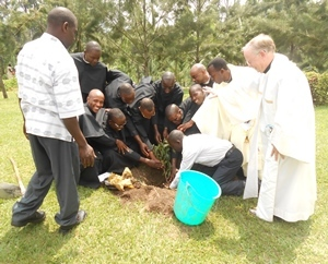 The newly professed in East Africa and their staff plant a tree to celebrate their Novitiate year