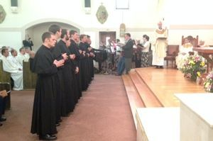 The newly professed line up in Sacred Heart Church to receive their Cross and Anchors