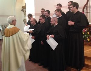 The newly professed receive their first letters of obedience
