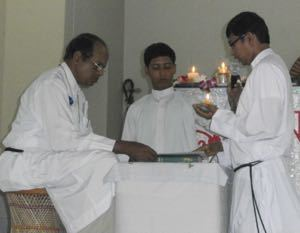 Br Rodrigues receiving the Final Professions