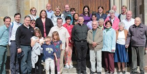 Notre Dame administrators pose for a picture along with parishioners outside of Notre-Dame de Sainte-Croix