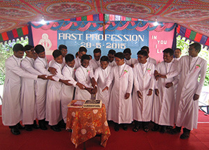 The 2015 First Profession Class in India cuts a cake in celebration