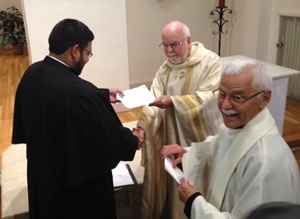 Mr Felipe Campos, CSC, receives his letter of obedience from Fr O'Hara, CSC
