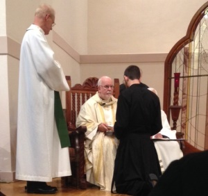 Mr Zachary Rathke, CSC, makes his First Profession to Fr O'Hara, CSC