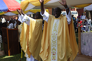 Newly Ordained Fr Arnold Jawiambe, CSC, and Fr Linus Nviiri, CSC