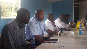 Fr Cyprian Binaka, CSC, and other Holy Cross members at a construction meeting