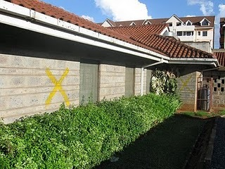 The previous house of formation in Kenya with the yellow x's marking it for demolition
