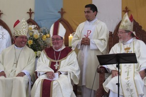 Bishop Izaguirre, Bishop Colgan, and Bishop Strotmann share a light-hearted moment in the Mass of Ordination