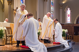 Fr Warner And Fr O'Hara Lay Hands During The Rite Of Ordination