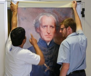 Fr Ashim Theotonius Gonsalzes, CSC, And Seminarian Michael Thomas, CSC, Hang A Poster Of Moreau For The General Chapter