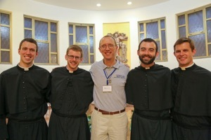 Joe Pedersen, CSC, Michael Thomas, CSC, Ryan Pietrocarlo, CSC, And Brogan Ryan, CSC, Take A Picture With Their Superior Fr John Herman, CSC, At The General Chapter