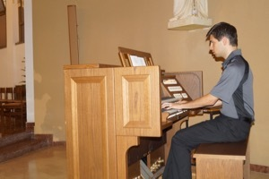 Fr Dennis Strach II, CSC, Plays The Organ At Liturgy For The General Chapter