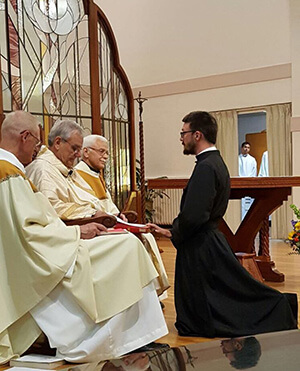 Cameron Cortens, CSC, Professes His First Vows To Fr Beauchamp