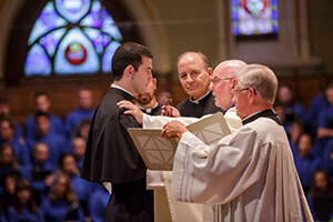 Michael Palmer, CSC, receives his Final Profession Crucifix