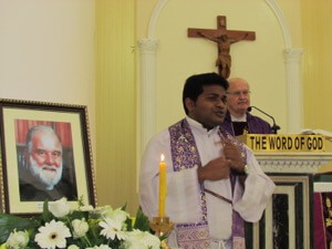 Fr Biju Signs During A Mass