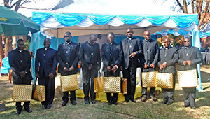 The nine Newly Ordained receive their gifts in the celebration after their Ordinations