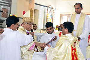 Fr Rajesh Pasanna Has His Hands Anointed In The Ordination Rite
