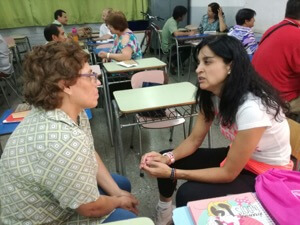 Two Parishioners From San Roque Discuss The INFAM Presentation