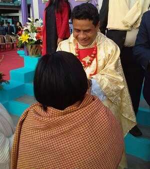 Fr Arbok receives congratulations after his Ordination