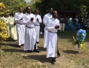 The five to profess Final Vows enter the Mass in Ghana