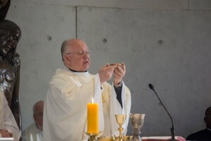 Fr Robert Epping, CSC, offers the Eucharist