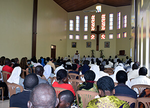 Fr. Abraham preaching viewed from back of the church