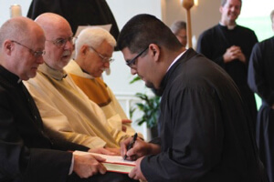 John Sebastian Gutierrez professes his vows to Br Zaydak