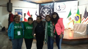 Fr Jose Luis Tineo greets pilgrims arriving for the Holy Cross Youth Gathering in Lima