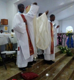 Bishop Yves-Marie Pean, CSC, presents the newly ordained deacons to the assembly