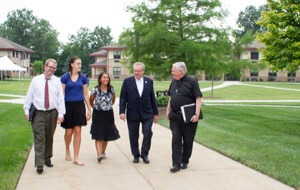 Fr Tyson walks across Holy Cross College's campus