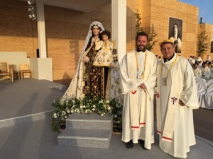 Fr David Halm, CSC, and Fr Jose Ahumada, CSC, in the sanctuary for the Papal Mass in Santiago