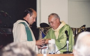 Fr Laurence Olszewski, CSC, celebrates the first Mass in the new parish in 2001