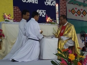 Fr James Cruze receives the Final Professions of Khokun and Bikash