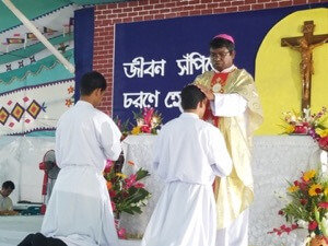 Bishop Tudu ordains Khokun and Bikash to the Deaconate