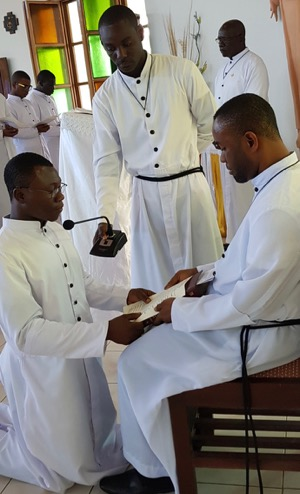 Br John Badu Affum, CSC, receives the First Vows of one of the novices in 2018