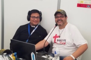 Seminarian Gabriel Fuentes, CSC, does a radio interview at WYD