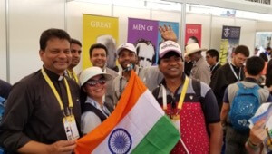 Fr Pinto Paul, CSC, takes a picture with Indian pilgrims to WYD at the Vocations Fair
