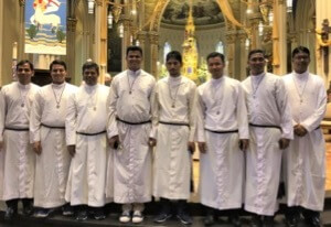 The Eight Holy Cross Brothers who participated in