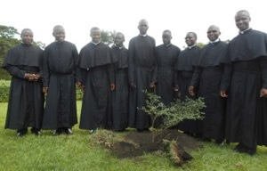 2019 Newly Professed in East Africa take a picture with the tree they planted
