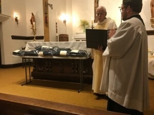 Fr Ken Molinaro, CSC, Novice Master, blesses the habits of those to profess First Vows