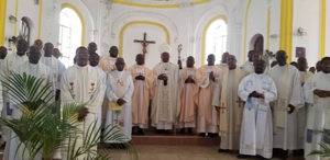 The newly ordained in Haiti with the Archbishop and the concelebrants